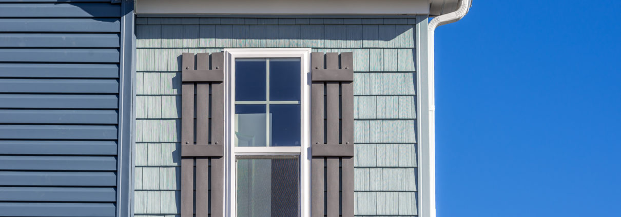 A house outfitted with vinyl shake siding