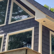 Exterior of home with blue vinyl shake siding that requires minimal maintenance.