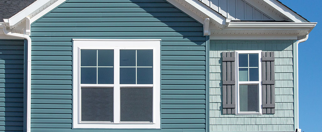 Newly installed green vinyl siding.